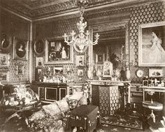 "Queen Victoria's Private Sitting Room, 1890's. Queen Victoria's Sitting Room lay within the King's Tower at the South East corner of the Castle with the main window facing south with a view of Windsor Great Park and The Long Walk. Directly above her were the Royal nurseries. By the end of the 19th century her Private Sitting Room had become full of ornaments, photographs and mementoes, ""the orderly confusion of beautiful bric-a-brac"". - Windsor Castle"