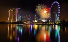 ferris wheel at night | Singapore-night-ferris-wheel-fireworks-water-surface-600x375_large