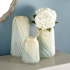 Delicate palm shapes dance across the surface of this gorgeous glass vase, offering an alluring flavor and subtle yet colorful palette. Center this beauty among a collection of stylish accent decor in a transitional space. Tall Candle Stands, Egg Designs, Flower Wall Decor, Unique Wall Art, Ceramic Table, Ceramic Flowers, Vases Decor, Accent Decor, Glass Vase