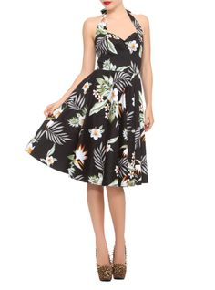 50's style stretch cotton dress with tropical flower and leaf fabric detail, fitted bodice with elastic back panel, and adjustable halterneck ties. Invisible back zip closure.