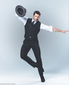Bust a move: Hugh has some fun during a photo shoot for Manhattan magazine's October issue..Prediction: Hugh Jackman will play James Bond 007 someday!!!..