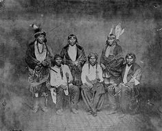 multipletrees: 1858 - Dakota Indian treaty delegation.  Standing: Big Eagle, Traveling Hail, Red Legs; Seated: Medicine Bottle, The Thief, unidentified.  Photographer: Charles DeForest Fredericks (1823-1894) -   Photograph Collection, 1858.