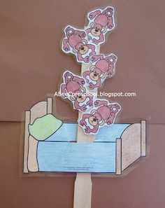 this is a fun craft to go with the song little monkeys jumping on the bed the children will color and paste the monkeys on a paint stick then color a bed