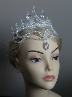 This tiara measures 3 inches at its highest peak and was created using craft pearls and 123 crystals AB for exceptional sparkle and 4 large crystal drops. Contact me if you are looking for something similar for a custom order.