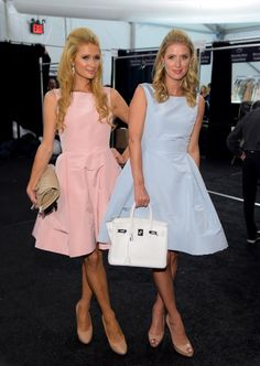 Paris Hilton and Nicky Hilton pose backstage at the Dennis Basso fashion show during Mercedes-Benz Fashion Week Spring 2015 at The Theatre at Lincoln Center on September 8, 2014 in New York City