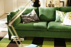 That green sofa