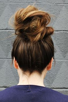 The Lazy Girl's Guide to Easy Messy Bun Hair Ideas | top knot for long hair from A Beautiful Mess