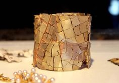 """""""mixed up"""" bracelet of yellow, red, green and white gold (John Iverson for Ornamentum Gallery)"""