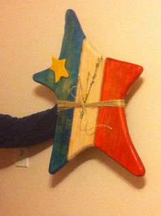 Wooden Acadian Star. We saw a star like this on our trip to New Brunswick this summer and couldn't find one to buy anywhere! On our way back I took a picture of the one we had seen and Pa made these up for the Acadian boys!