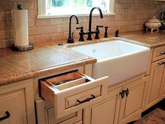 I'm seriously considering a farmhouse kitchen sink????