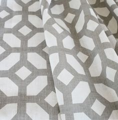 A neutral geometric fabric in a warm, taupe-grey on a creamy oyster/off white background.Ideal for drapery, curtains, roman blinds, pillows, cushions and some light to medium weight upholstery.Content: 100% LinenWidth: 54