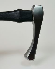 Sinking hammer - made of 4140 with a blackened hickory wood handle.