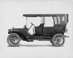 1909 Packard 30 Model UB, 4-cylinder, 30-horsepower, 123.5-inch wheelbase, 7-person touring car, fitted with canopy roof.""