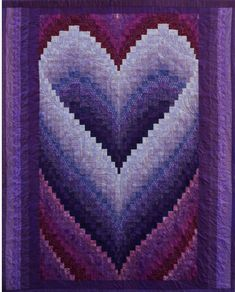 the most beautiful Bargello heart quilt i've ever seen