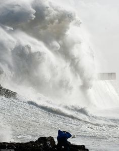 SHUTDOWN! Trains suspended, flights cancelled and thousands without power as 110mph St Jude's Storm brings travel chaos for millions