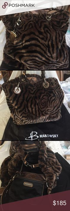 B Makowsky Animal print Leather and faux fur Purse B Makowsky Animal print Leather and faux fur Purse is like New, no flaws excellent condition. Handbag is huge (this is the XL tote) comes with matching makeup clutch and dust bag. Faux fur is brown and black with silver hardware and bronze colored genuine leather trim. This bag is stunning and perfect!!!!!!!!!!! It is absolutely gorgeous and looks like you just left the department store. With the black brown silver and bronze/gold…