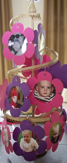 Fun photo tree- 12 months of pictures used as a centerpiece for a 1st birthday party....the theme used elephants, flowers and hearts in purples and pinks