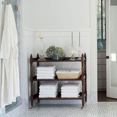 Bathroom Towel Storage Ideas: Just because it was meant for the living room or bedroom, doesn't mean you can't use it in the bathroom. This shelving unit found new purpose as a place to store towels. It reminds me a bit of a changing table. This would be a great way to repurpose one of those!