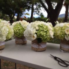 burlap and lace centerpieces with green and white hydrangea by Bella Fiori