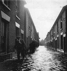 A man wades through flooded streets in Great Yarmouth, Norfolk Norwich Norfolk, Great Yarmouth, Storm Surge, Seaside Resort, Uk Photos, Local History, Natural Disasters, East Coast, Britain
