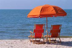 Meet me on the beach under the orange umbrella!