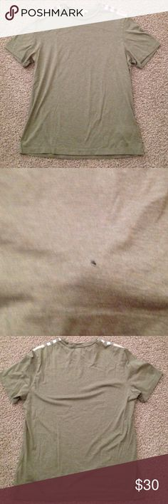 Authentic Burberry Shirt Good condition. Small hole in the shirt please see pictures Burberry Tops Tees - Short Sleeve