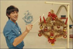 Blue Peters Advent Crown with John Noakes. Good old Blue Peter.i remember watching him make it out of coat hangers tinsel and double sided sticky tape. 1970s Childhood, My Childhood Memories, Those Were The Days, The Good Old Days, Christmas Past, Vintage Christmas, Blue Peter, Advent Candles, I Remember When