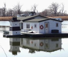 House boat on Horseshoe Pond complete with mini lighthouse, at Presque Isle Erie Pa.