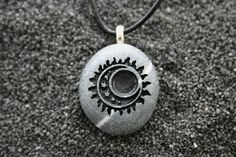 Sun Moon Stars Engraved Stone Ocean Pebble Pendant.