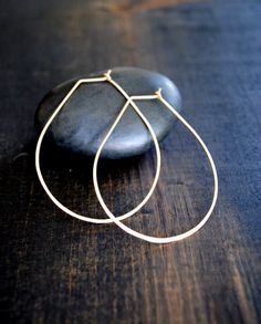 "From jeans and a tee to night on the town, Teardrop hoops put the finishing touch on any outfit. - Handcrafted from recycled Argentium Silver, 14K Gold Fill or Solid 14K Gold - 2"" long - Free Shipping"