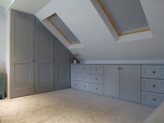 Significance of shaker style fitted bedroom furniture Fitted wardrobes built into loft conversion. Storage drawer units shaker style doors and drawers. Pull out hanging rails. furniture layout windows Significance of shaker style fitted bedroom furniture Attic Loft, Loft Room, Attic Rooms, Closet Bedroom, Attic Bedroom Storage, Garage Attic, Small Loft Bedroom, Attic Wardrobe, Attic Playroom