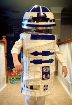 R2D2 Costume - One of those expanding clothes hampers, a garbage can lid, white sweats, white long sleeve shirt.  This was ALL done with Duck Tape and a black marker!! An easy weekend project!! We still have this, it lasts a few years!