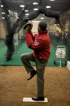 The President warms up before throwing out the first pitch at Nationals Park on Opening Day 2010.