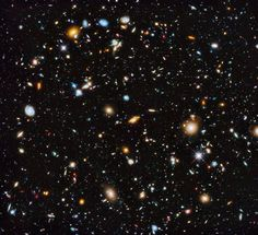 Hubble Ultra Deep Field. Thousands of blobs of various sizes and colors that are galaxies.