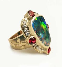Opal, ruby, and diamond ring in 18K yellow gold by artist Paula Crevoshay