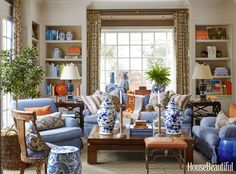 The Studys Sofa And Armchairs Are Upholstered In A Jasper Stripe Annika Lamps Mary McDonald For Robert Abbey Garden Stools JF Chen Left Mecox