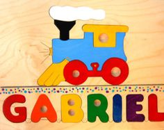 Your childs name with a train engine (choo-choo) piece makes a very special puzzle for your newborn or toddler. Makes a unique shower gift - darling nursery décor!  We can fit up to 7 letters plus the train engine on this puzzle. If your toddler has a different name, we can make it for you! Please type the exact spelling of the childs name in the Note to Seller area of your order. If you need a name puzzle with more letters, or prefer simply a name without a shape added, cut and paste the…