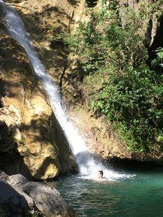 Swimming under waterfalls, Trinidad national park, Cuba