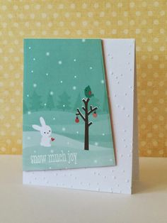 three umbrellas—patterned paper from Lawn Fawn. Used dies from Papertrey Ink for the tilted angle and attached it to a snow dot embossed card. The sentiment is from Hero Arts.
