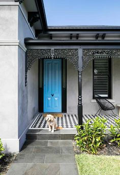 Front step: The playful black and white patterned tiles work seamlessly with the monochrome exterior palette. A seating area on the porch provides the perfect lookout for when children play in the front yard.