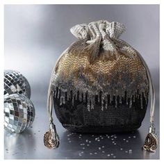 When it comes to evening dressing, this Silver Dysis Bucket Pouch will add the perfect dash of glamour to you look!  #ootd #Details #Festive #Potlis #Pouch #Weddings #Festivegifts #Weddingfavours #Mehndifavours #OnlineShopping #Online #Website #StealDeals #Bestsellers #Hot #NowTrending #shopping #Handbag #Accessories #HandEmbroidery #Embroidery #Trend #Lovetobag #Clutch #Bag #Handbags #madeinindia #Fashion #designer #glamour #lovetobag #baglove #potli #weddingready #winterwedding #crafts #brides Handbag Accessories, Fashion Accessories, Potli Bags, Designer Clutch, Couture Bags, Embroidered Bag, Online Bags, Beaded Embroidery, Purses And Handbags
