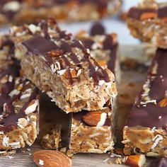 Homemade healthy no bake peanut butter granola bars will be your new favorite snack. These chewy granola bars are packed with wholesome ingredients like peanut butter honey chia seeds flax almonds and drizzled with dark chocolate. Healthy Bars, Healthy Sweets, Healthy Baking, Healthy No Bake, Healthy Protein Balls, Healthy Granola Bars, Vegan Protein Bars, Protein Snacks, Healthy Cereal Bars