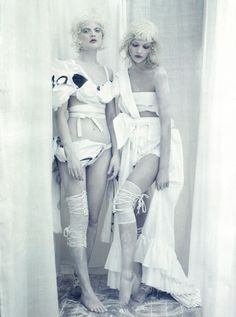 Editorial from Vogue Italia April 2010  Photographed by: Paolo Roversi  Fashion Editor: Jacob K.  Models: Sasha Pivovarova & Guinevere van Seenus