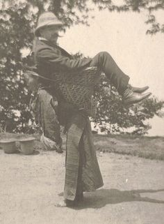 A Sikkimese woman carrying a European man on her back, West Bengal, India, c. 1900.