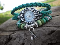 New watch I made myself using green faux suede cord braided in 4 and wooden and metallic beads. Do you like it?