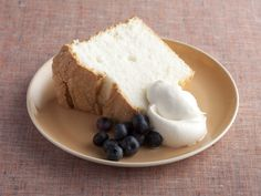 Perfect Angel Food Cake Recipe! So amazingly moist and light! I paired it with fresh blueberries and strawberries and homemade whipped cream! :)