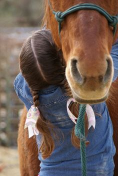 not much is stronger than a girl's love for  her horse. This could be me when I was younger (it's not though!)