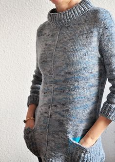 Understated gray sweater tunic - with  surprise electric blue pockets! Knitting pattern on Ravelry. By my friend Anke.
