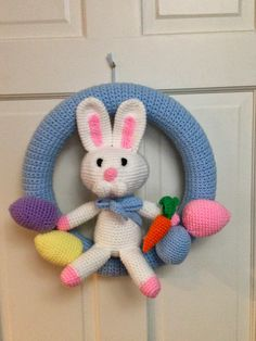 Crocheted Wreath Bunny Pattern free from http://www.yarnspirations.com/patterns/baby-s-bunny.html