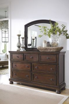 A beautiful Dresser and Mirror Set from Ashley Furniture for the perfect Vintage Casual style in a dark Cherry color.  Other features include Dark Bronze Hardware, Dovetail Construction and Cedar lined drawers.  Find it here: http://carolinafactoryoutlet.com/queen-bedroom-package-dresser-mirror-queen-sleighbed.html